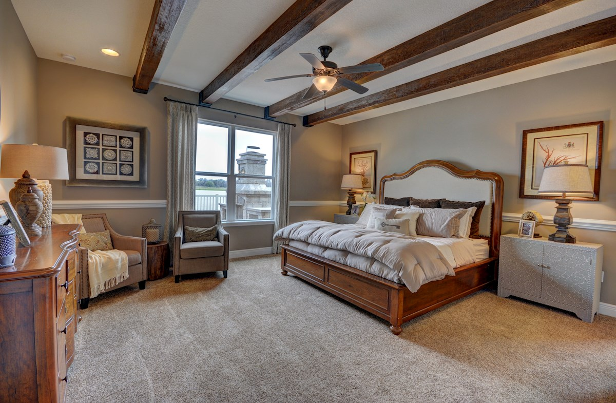 The Reserve at Pradera Redwood Master bedroom with faux wood beams