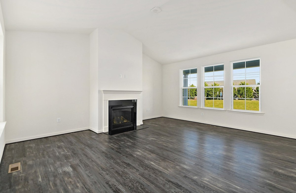 Dirickson quick move-in Dirickson great room featuring a fireplace and designer flooring