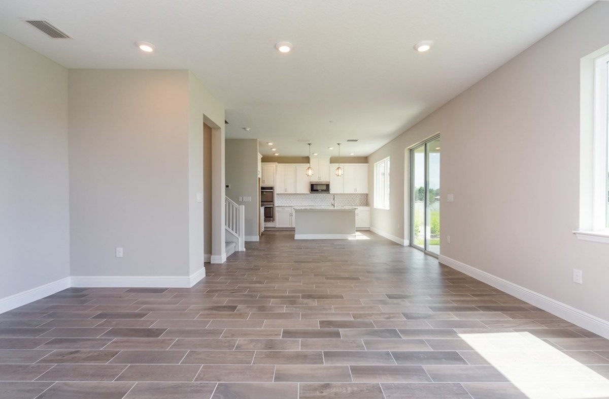 Sand Dollar quick move-in Breakfast area and great room with wood-look tile