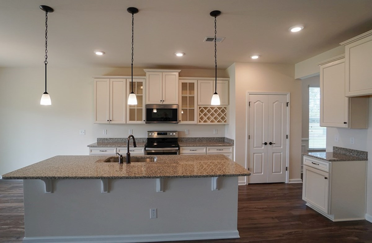 Valleydale quick move-in kitchen is open and features granite countertops