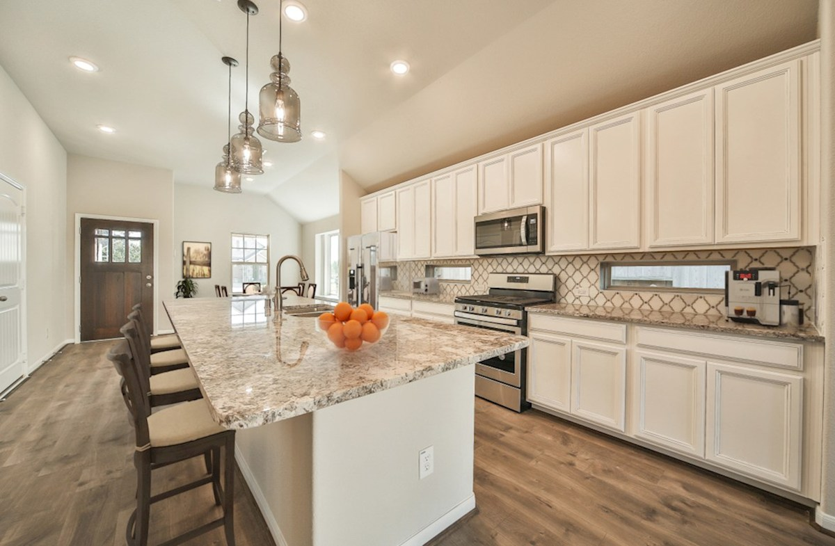 Villages at Harmony Hickory kitchen with pendant lighting and granite countertops
