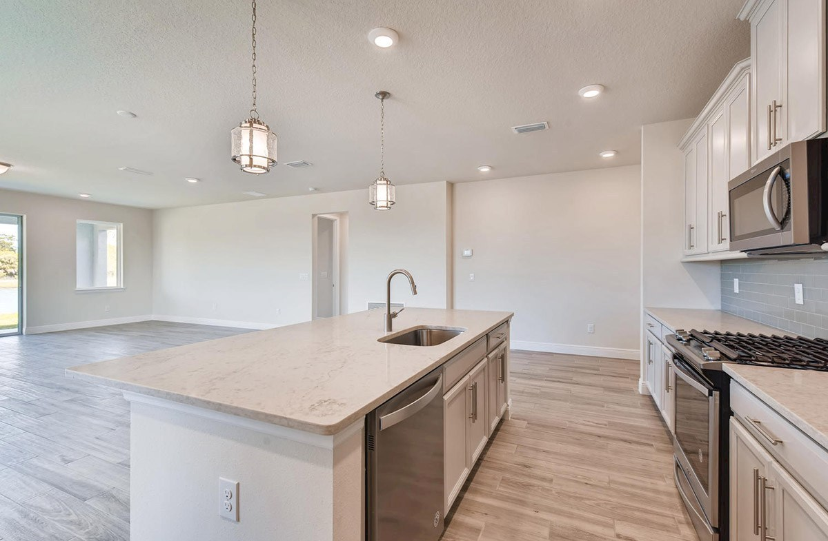 Bayview quick move-in Open concept kitchen and great room with wood-look tile floors