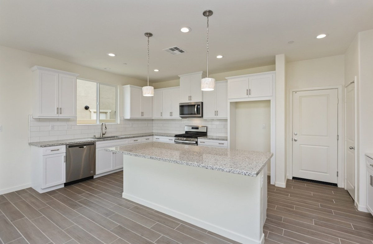 Chardonnay quick move-in Gourmet kitchen boasts an oversized island, stainless steel appliances, and stunning granite countertops