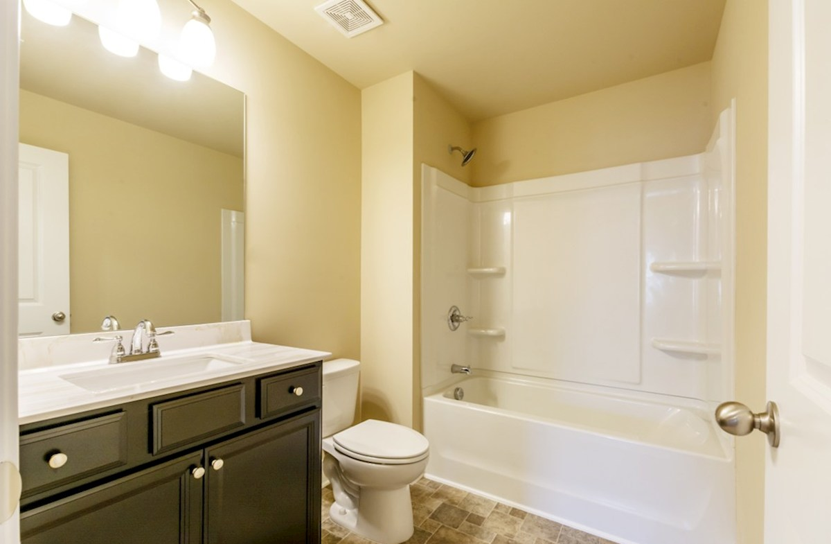 Milford Point Duval Secondary Bathroom with dark brown cabinets