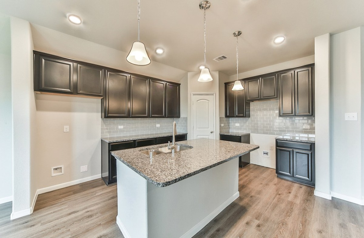 Sierra quick move-in kitchen with granite countertops and pendant lighting