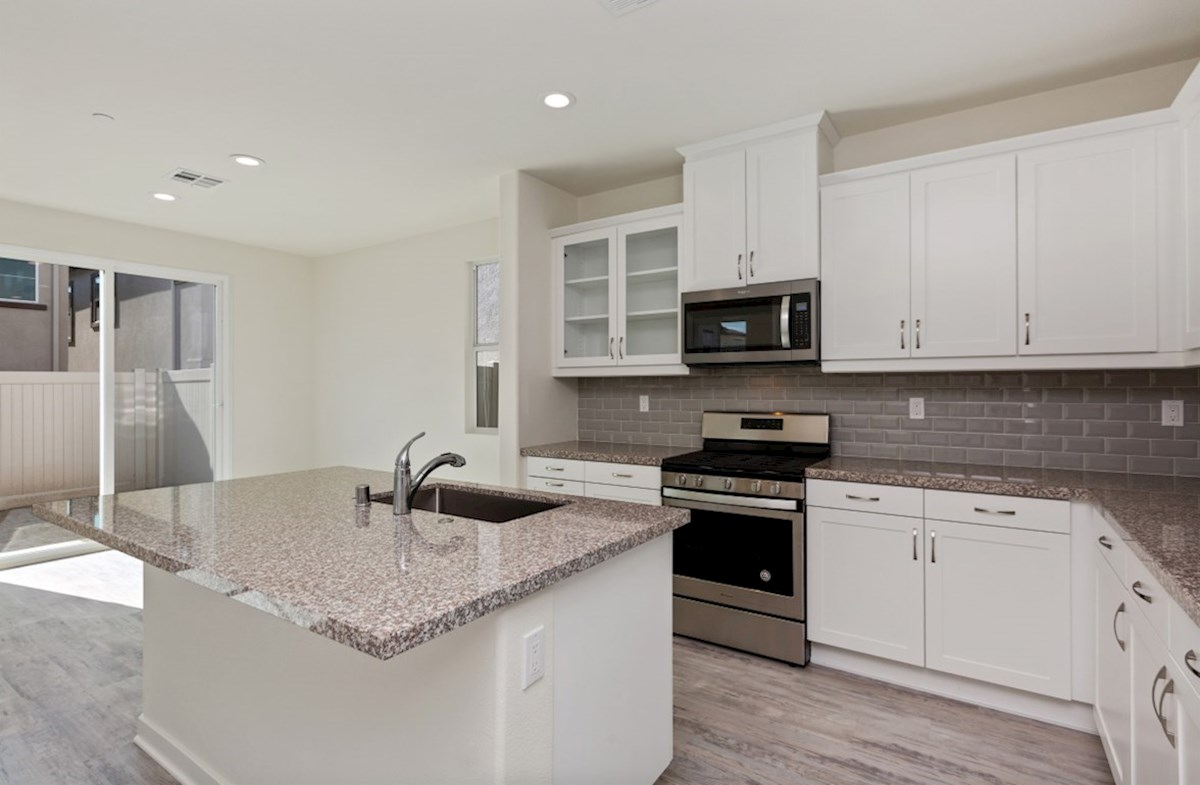 Suncup quick move-in Granite countertops and center island with sink provide the ideal location for food preparation