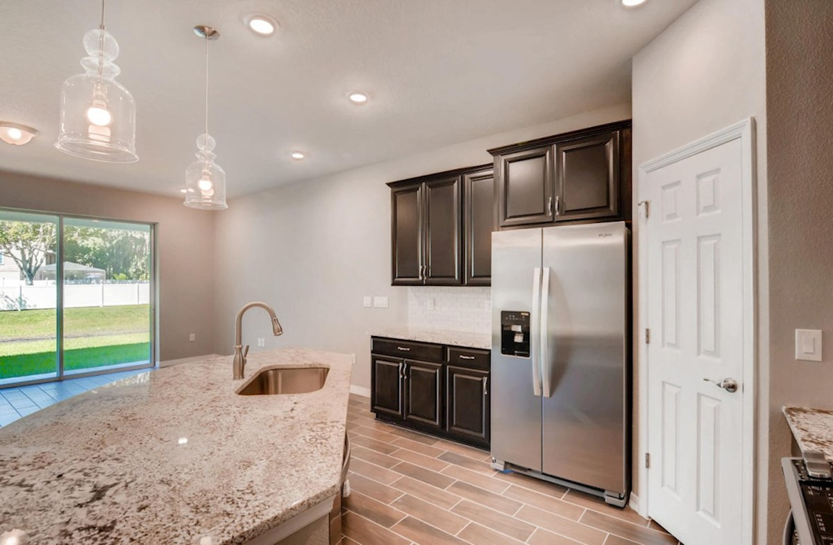 Siesta Key quick move-in Kitchen with island that opens to the great room