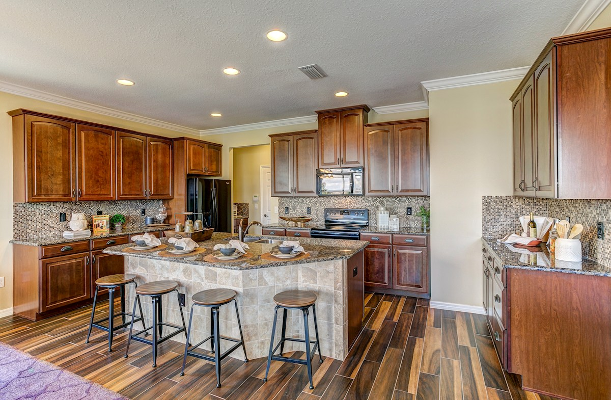 The Reserve at Pradera Captiva Kitchen with granite countertops and center island with sink