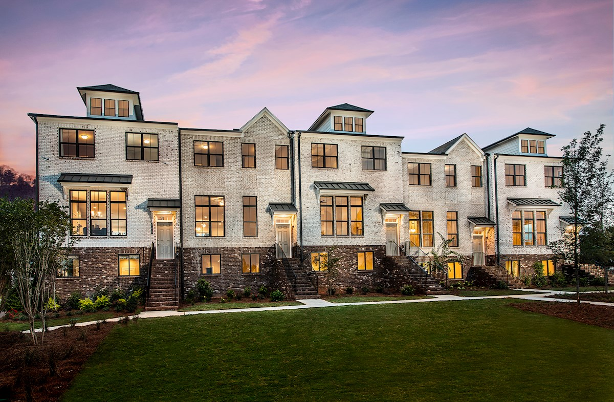 3-story townhomes with brick front exteriors