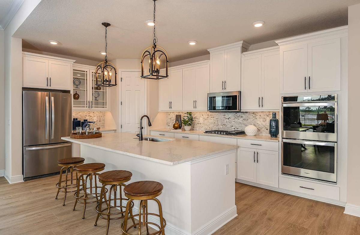 Open kitchen with white cabinets and large island