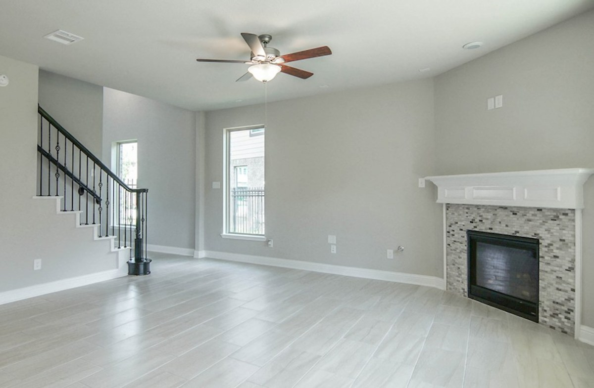 Sycamore quick move-in great room with tile floors and gas fireplace