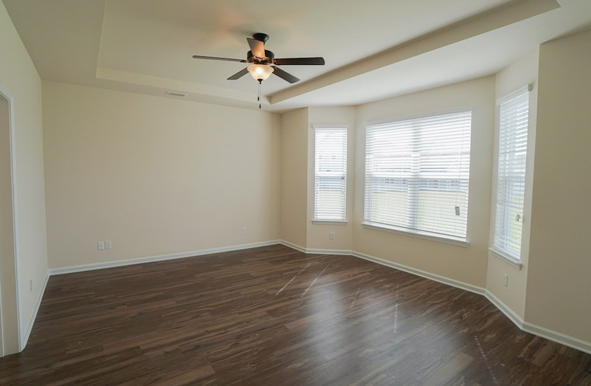 Valleydale quick move-in master bedroom features tray ceilings and bay windows
