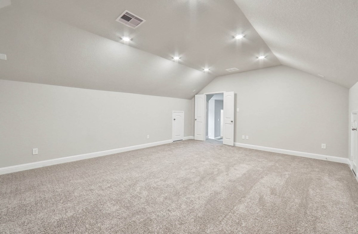 Galveston quick move-in large media room with sloped ceilings and carpet floors