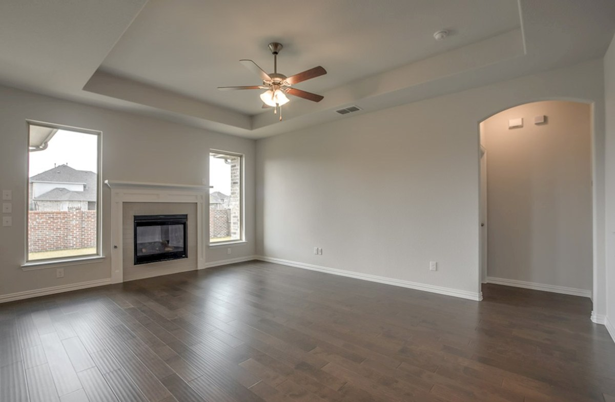 Avalon quick move-in open great room with wood floors and fireplace
