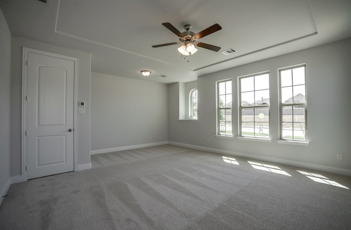Richland quick move-in master bedroom with large windows and tray ceiling