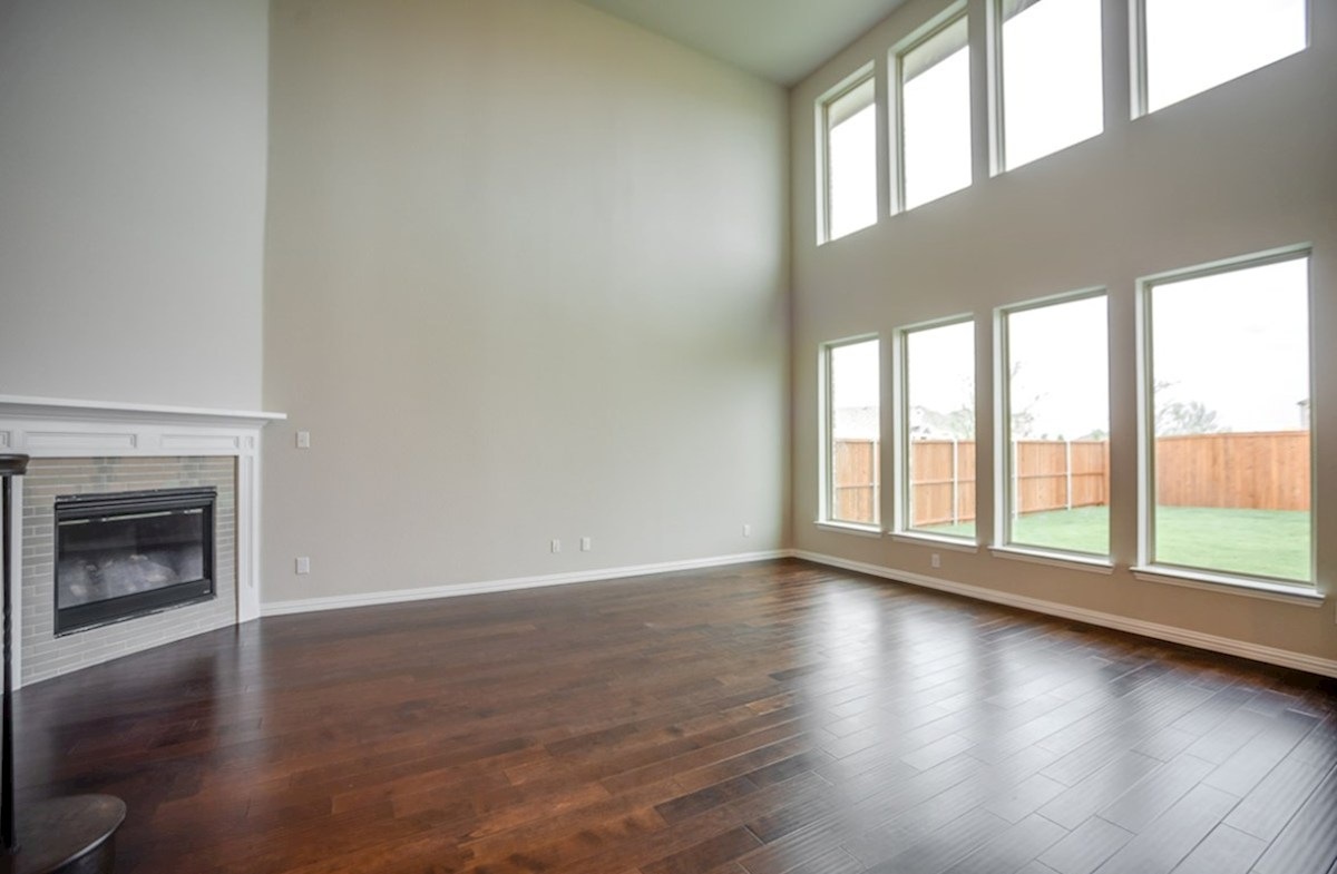 Madison quick move-in open great room with fireplace and large windows