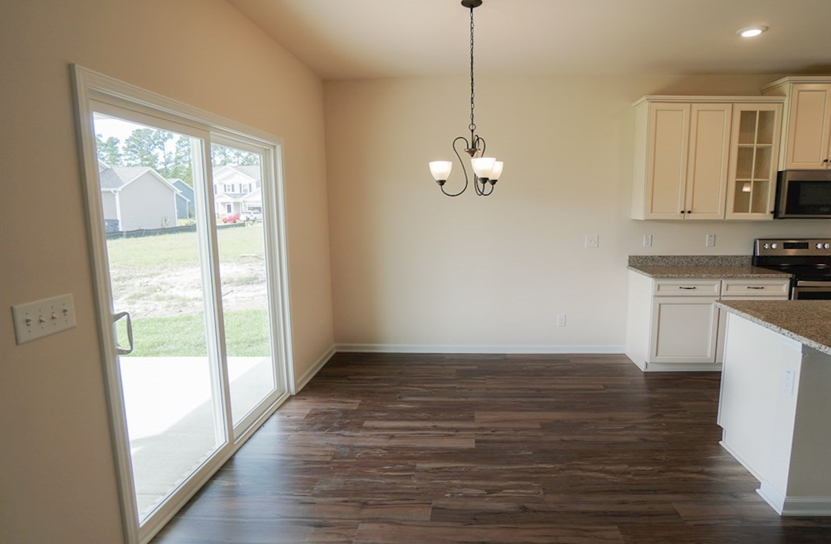 Valleydale quick move-in breakfast area with sliding glass door to the backyard