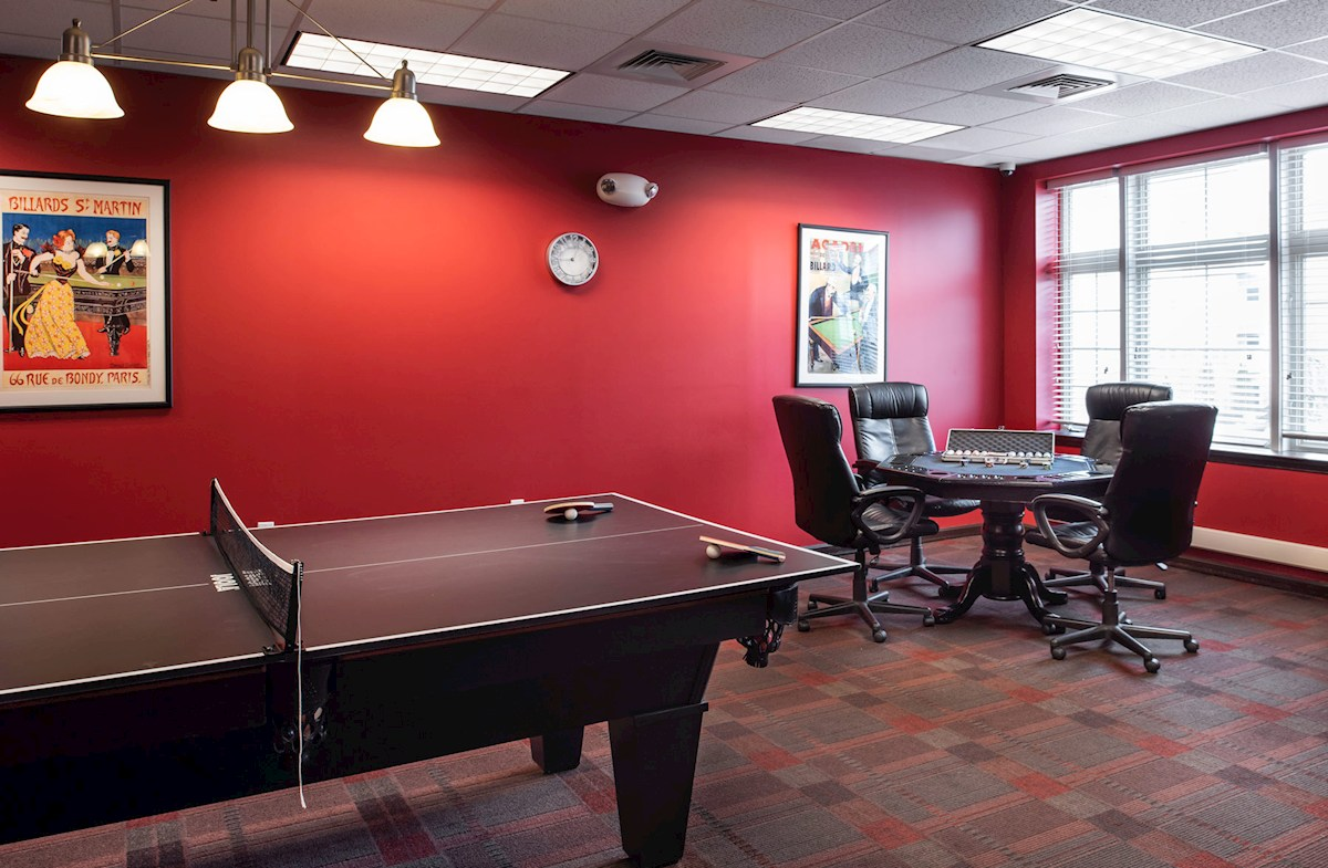 Clubhouse game room featuring ping pong and more