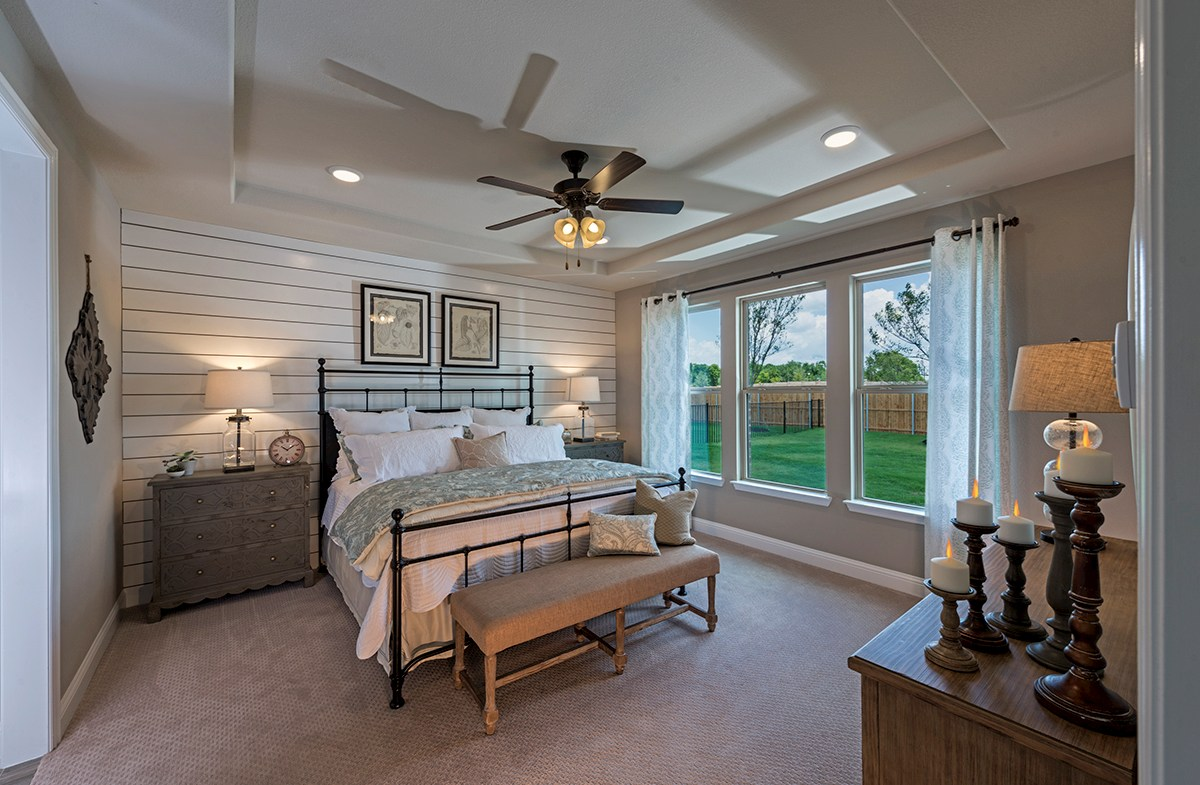 Creeks of Legacy Summerfield Summerfield master bedroom with elegant tray ceiling