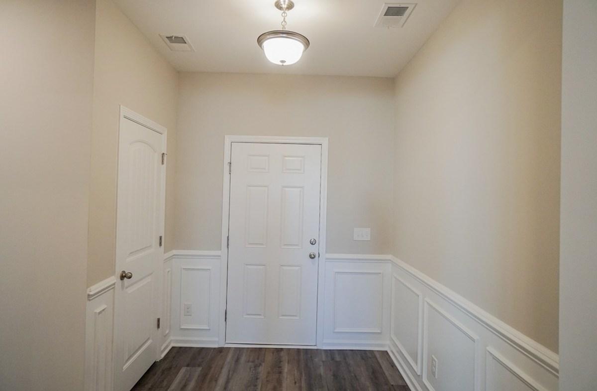 Summerton quick move-in foyer features elegant trim and framing