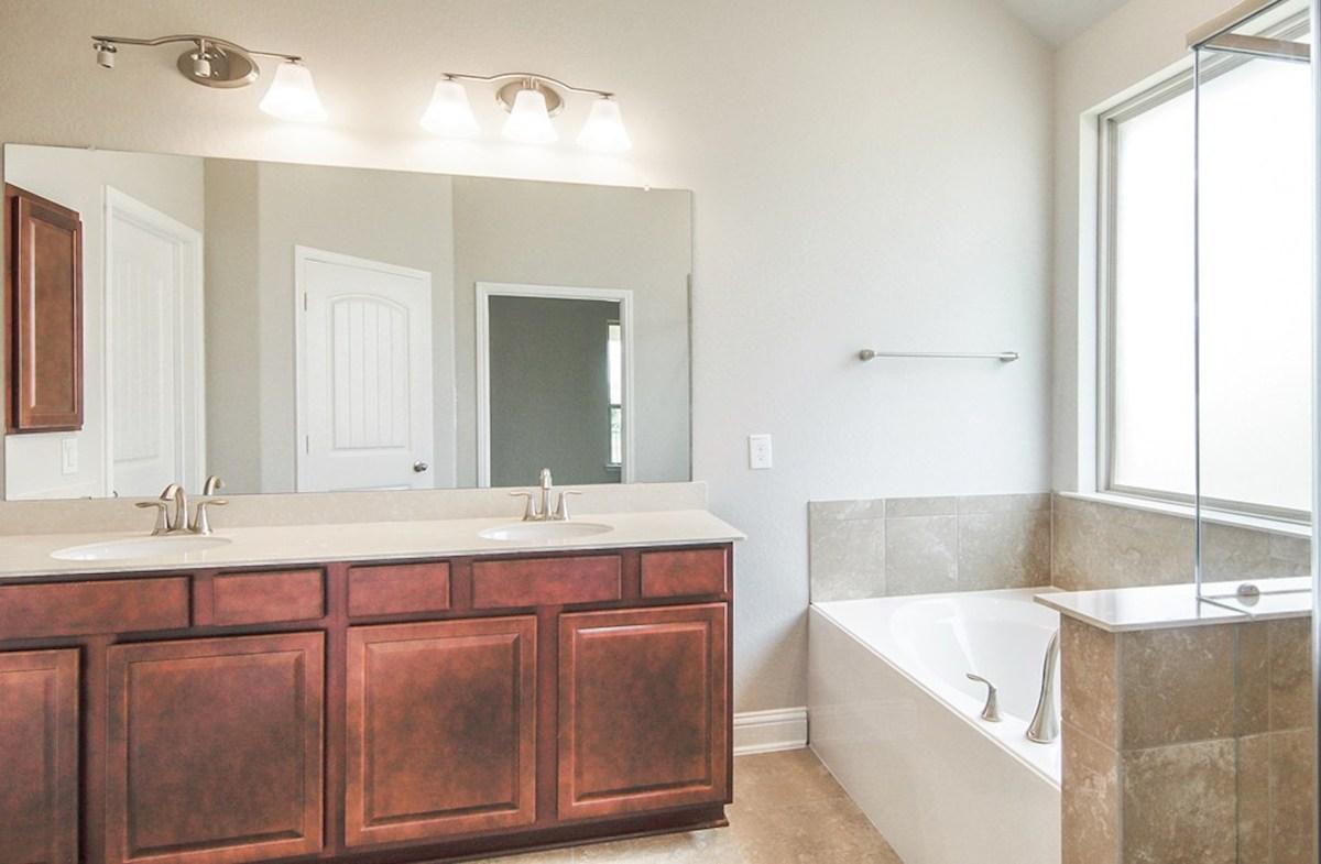 Capri quick move-in master bathroom with tile flooring