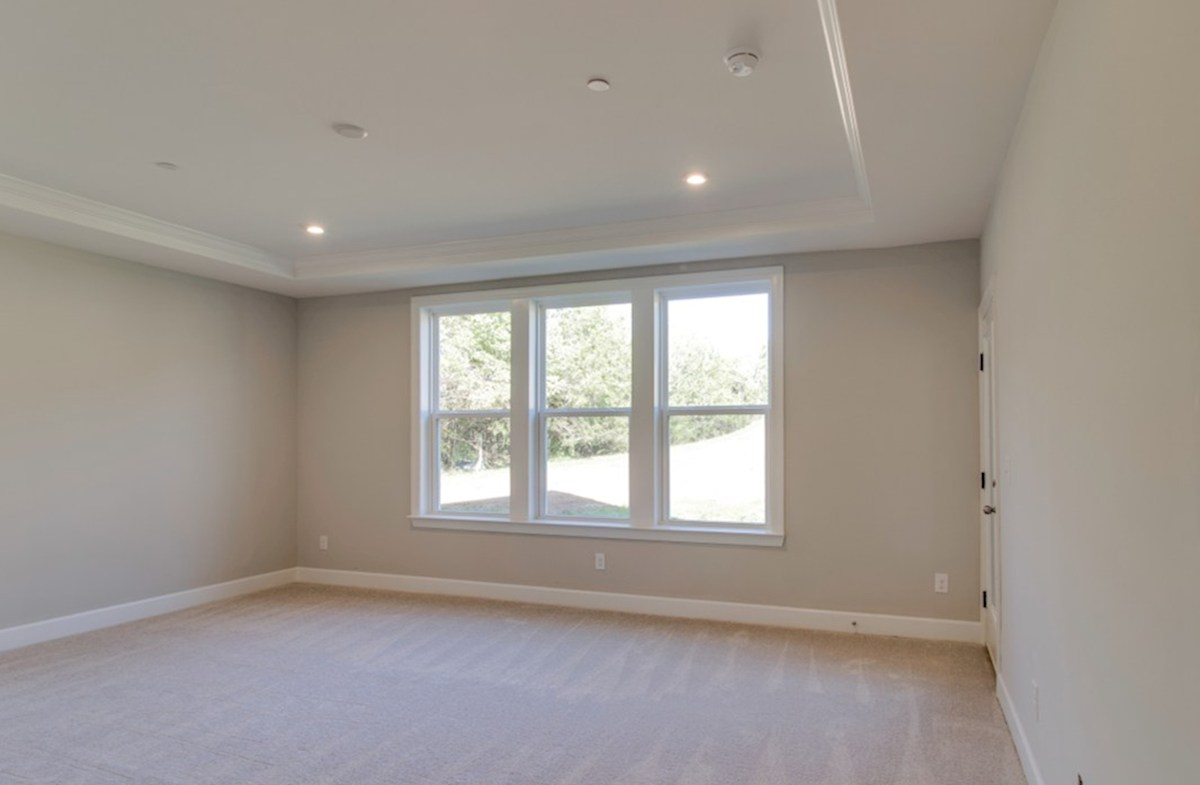 Dogwood quick move-in master bedroom with tray ceiling