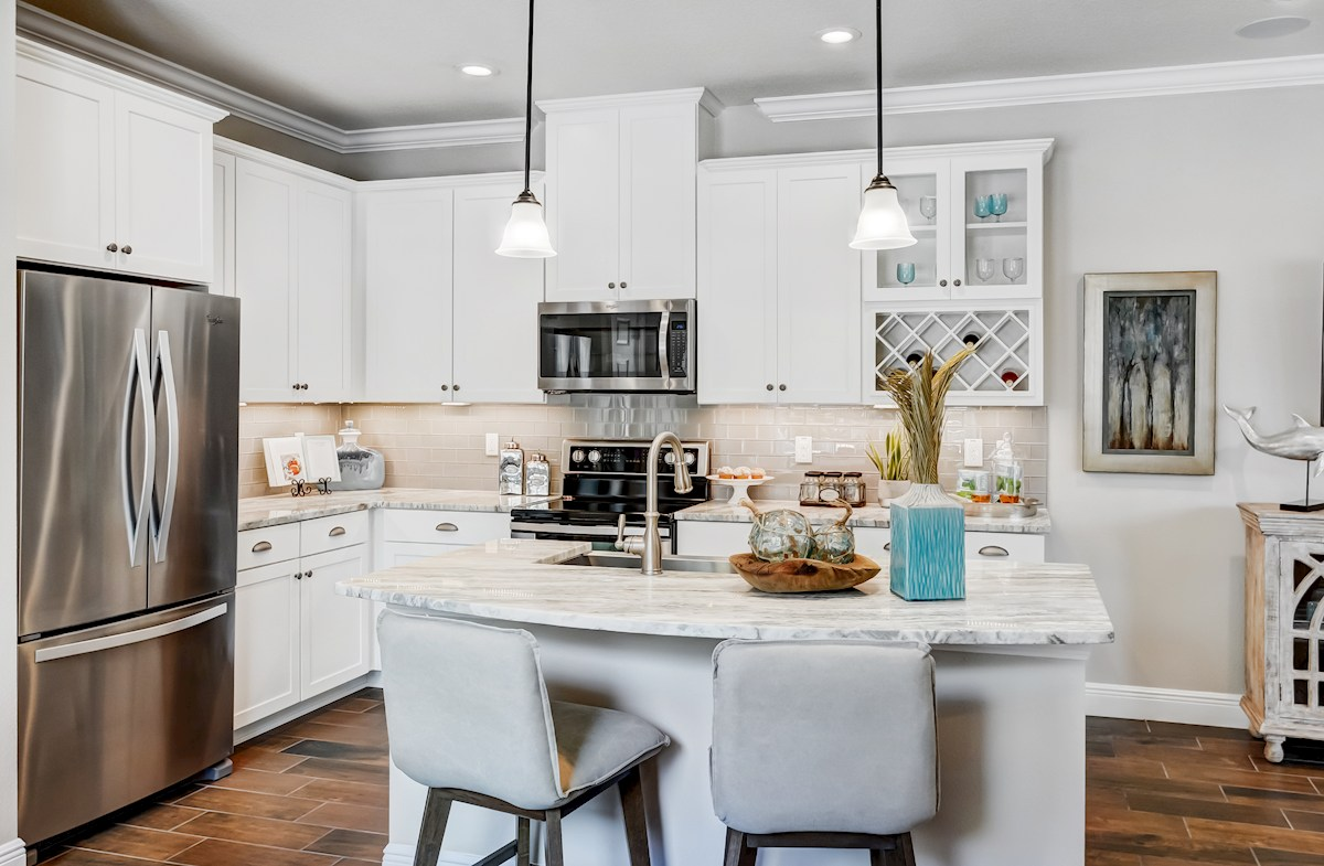 Kitchen with white cabinets and center island