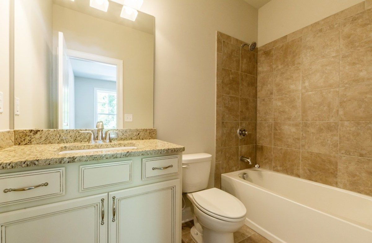 Langley quick move-in Secondary Bathroom with granite countertops