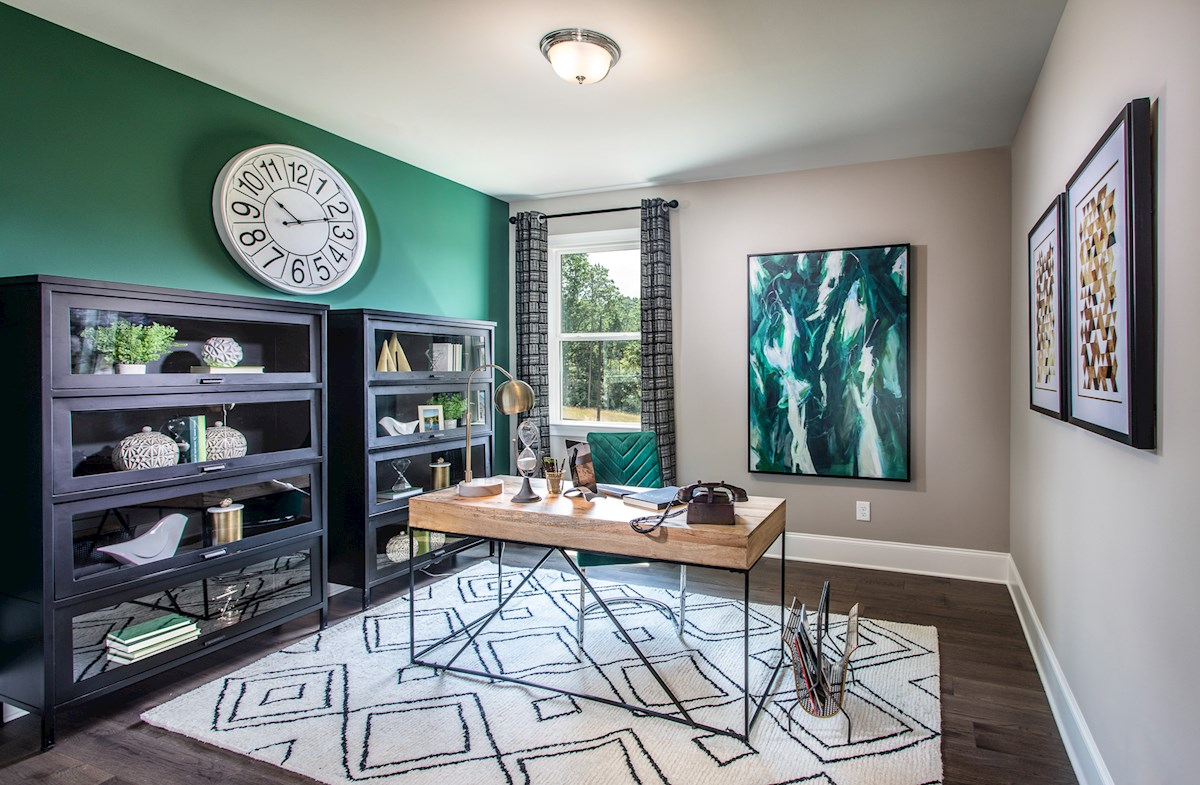 Office with green accent wall