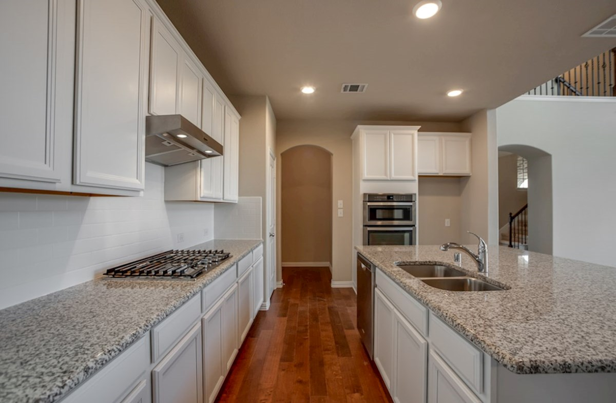 Fairfield quick move-in kitchen with white cabinets and island