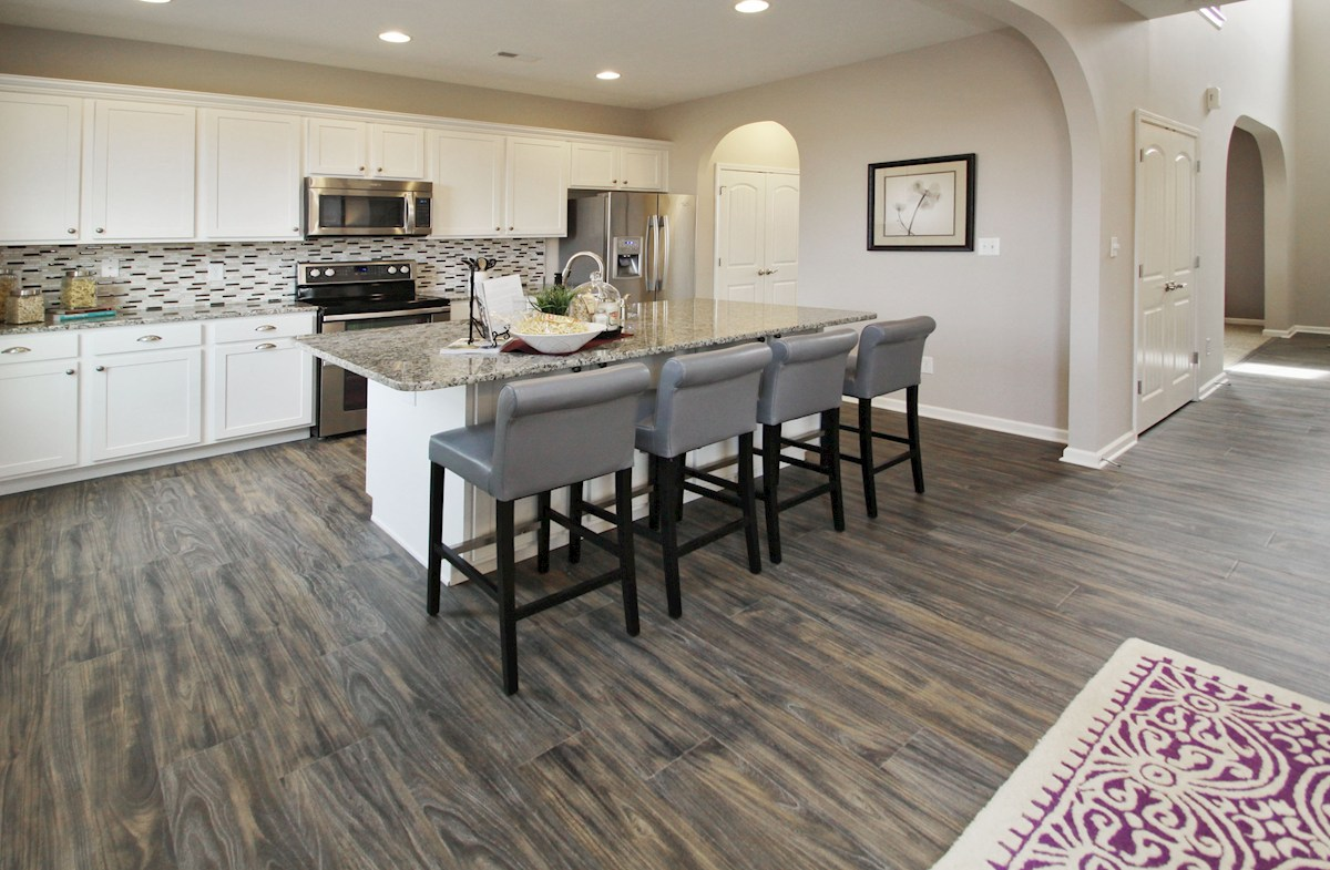 Heritage at Vermillion Bradley kitchen with large island and hardwood floors