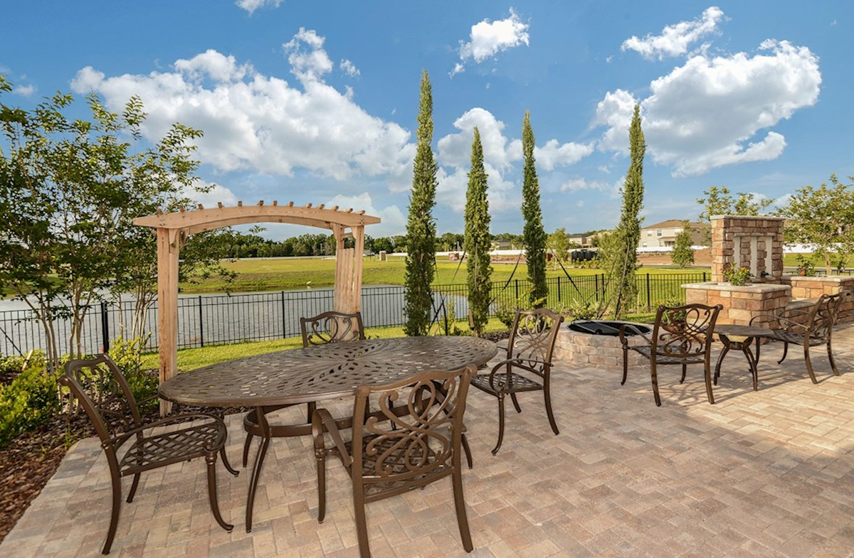 Reserve at Citrus Park Sea Breeze Paver patio with a firepit