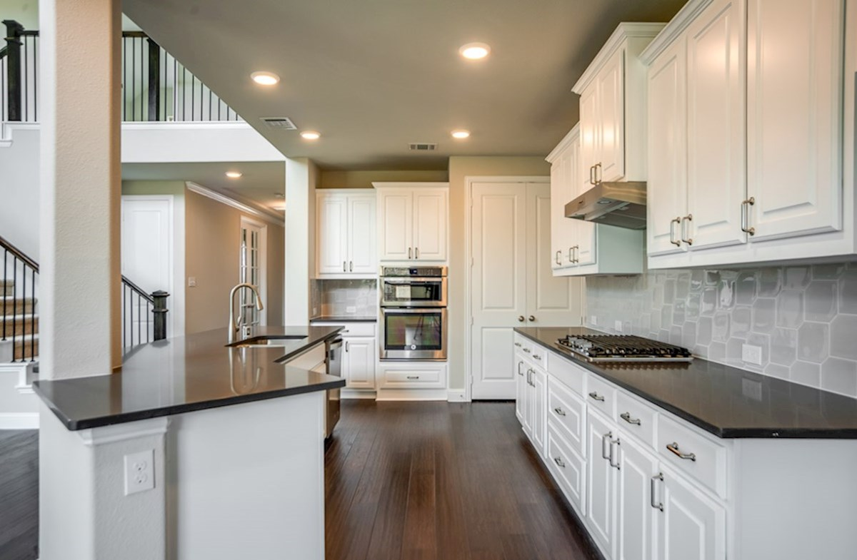 Brookhaven quick move-in open kitchen with white cabinets and large island