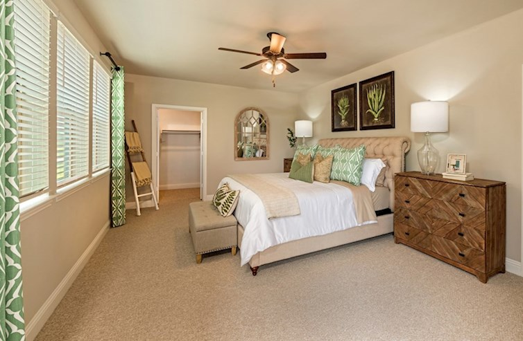 Gatherings® at Westview Wiltshire light-filled master bedroom with ceiling fan