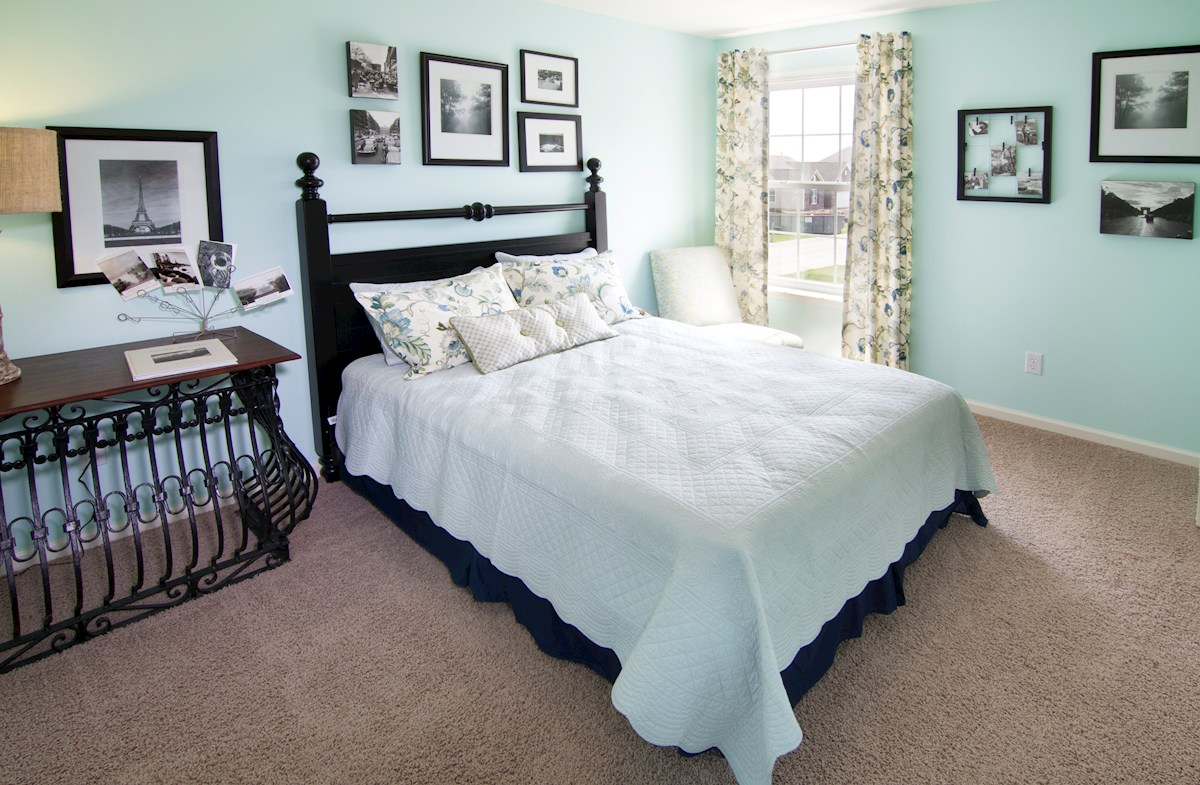 Shadow Creek Farms Hartford guest bedroom offers lots of natural light