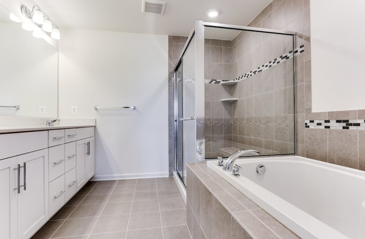 Taylor quick move-in Taylor master bath with a separate shower and tub