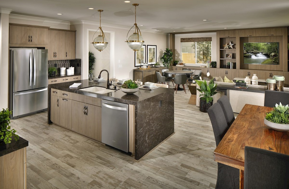 The Glen at Summerly Sonoma Entertain guests while preparing gourmet meals in this open-concept kitchen and great room.