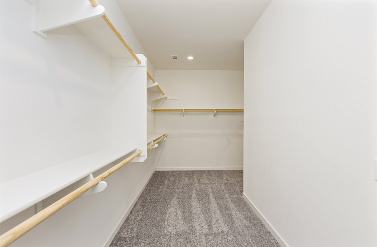 Piedmont quick move-in Walk-in closet is designed for easy movement between shelves and optimal hanging and storage space