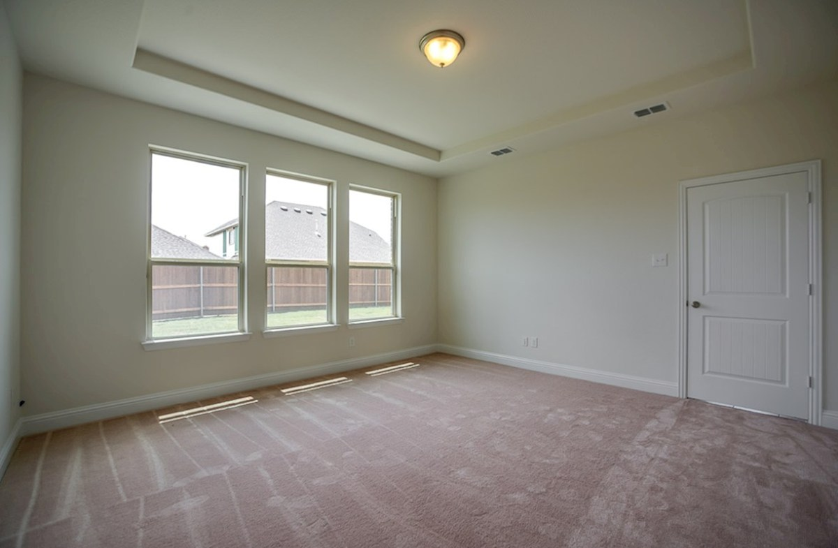 Summerfield quick move-in Large windows offer tons of light in the master bedroom