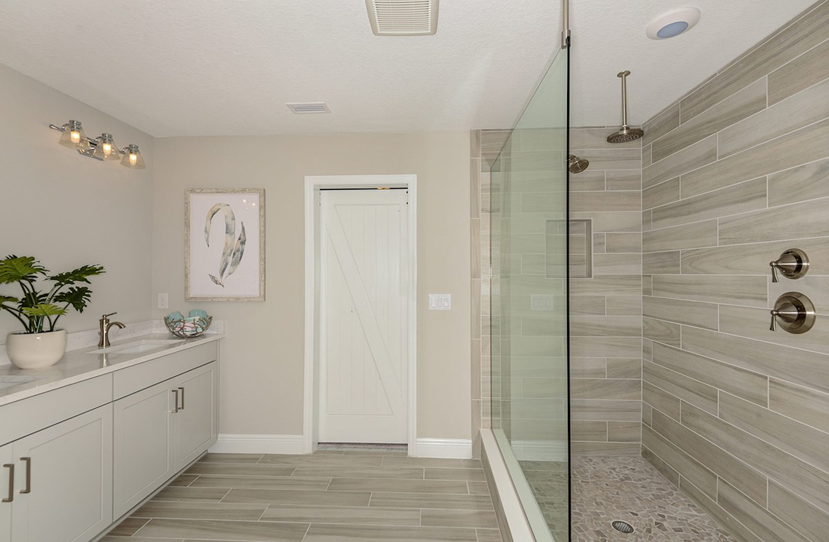 Master bath with dual sinks and sports shower