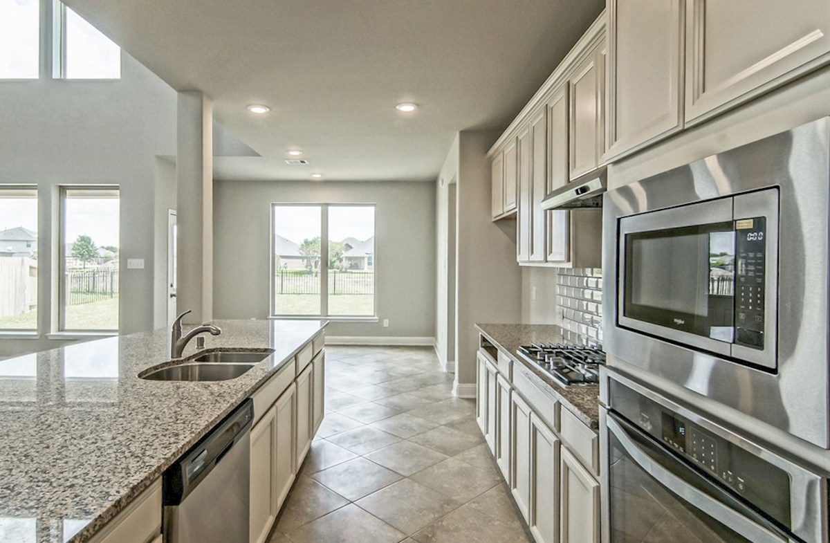 Armstrong quick move-in open kitchen with granite countertops and stainless steel appliances