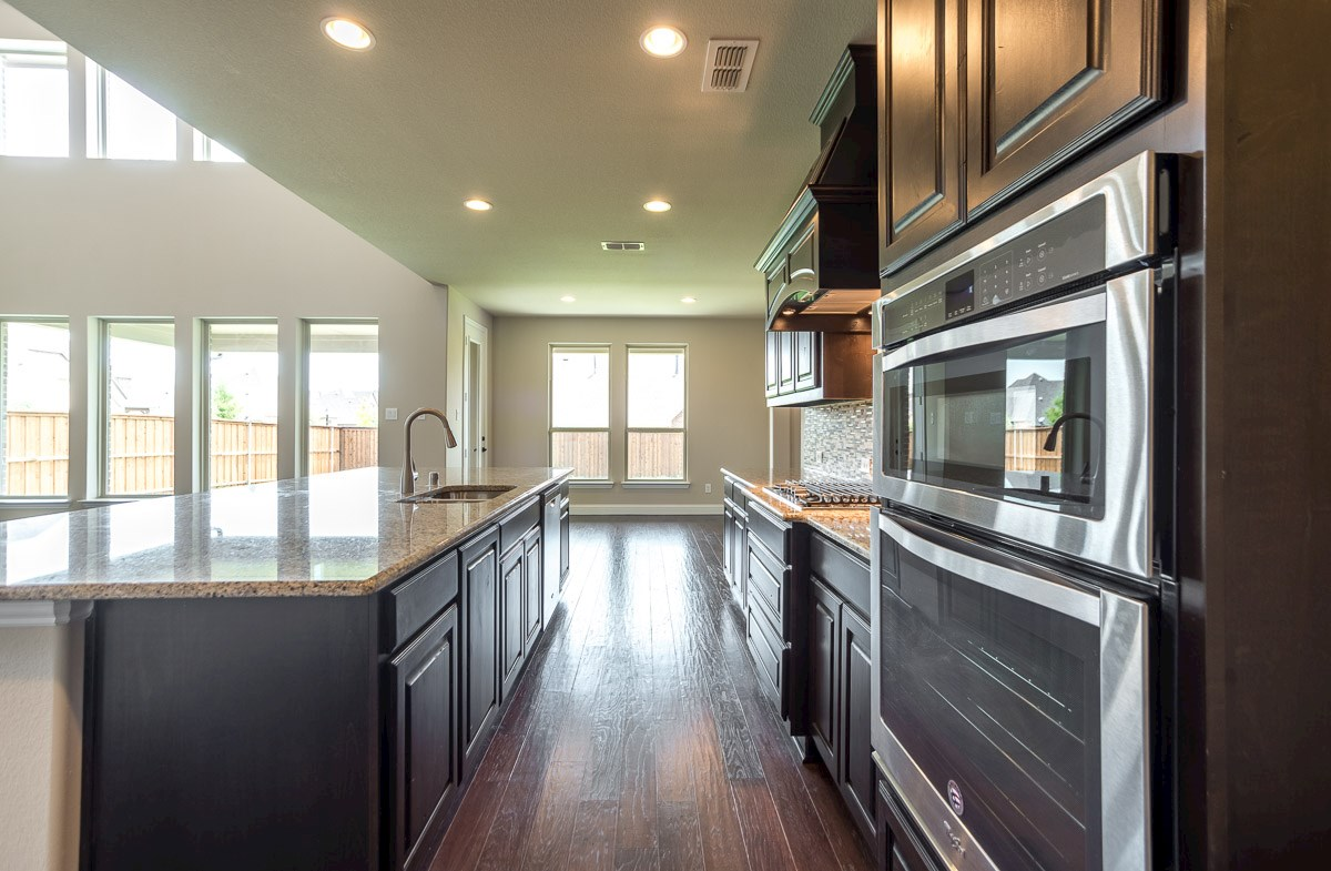 Gruene quick move-in kitchen opens to breakfast area and great room