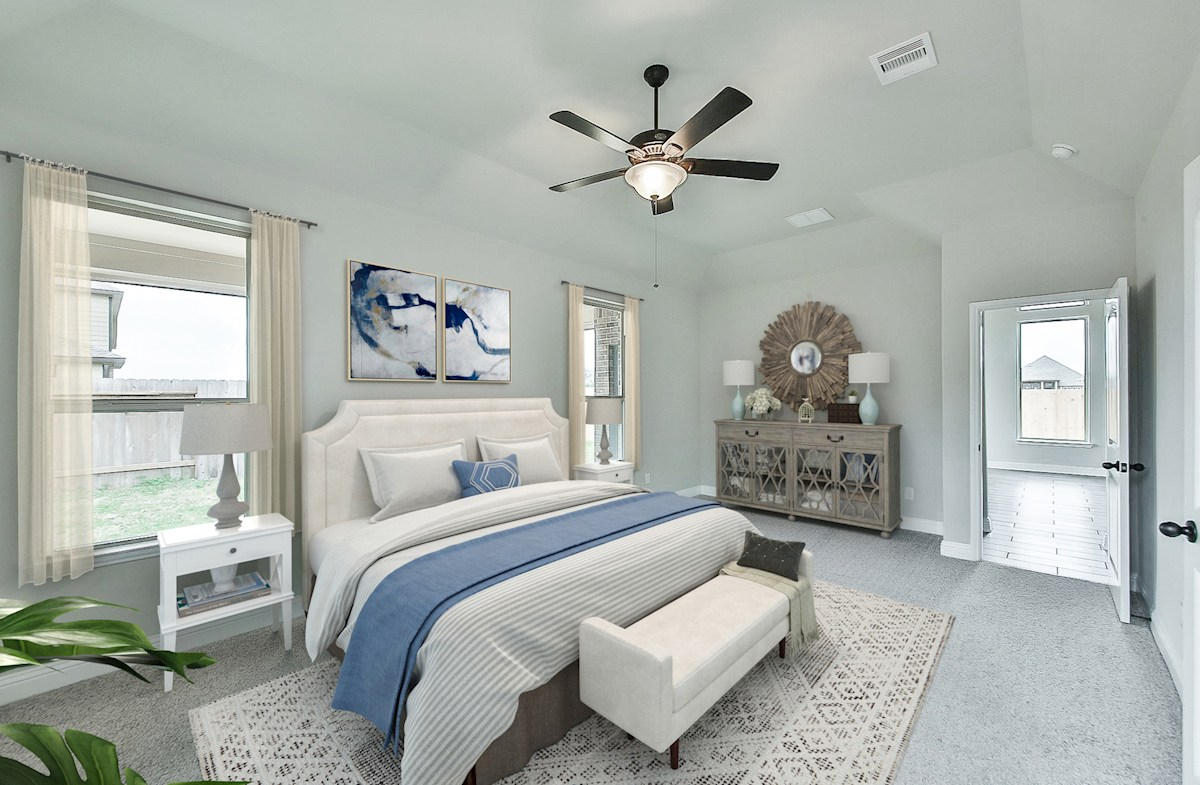 light filled master bedroom with ceiling fan