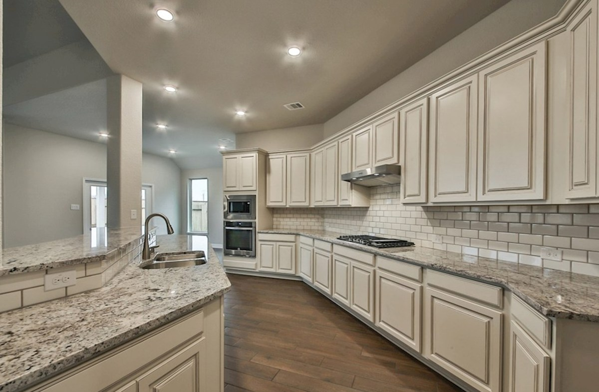 Fredericksburg quick move-in kitchen with granite countertops, tile flooring and stainless steel appliances