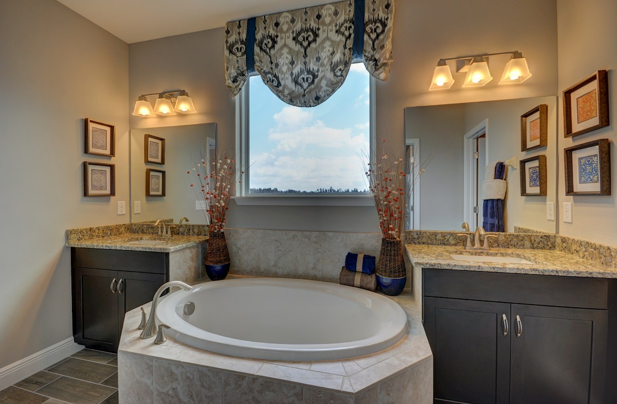 The Reserve at Pradera Anna Maria Master bath with tub and dual vanities