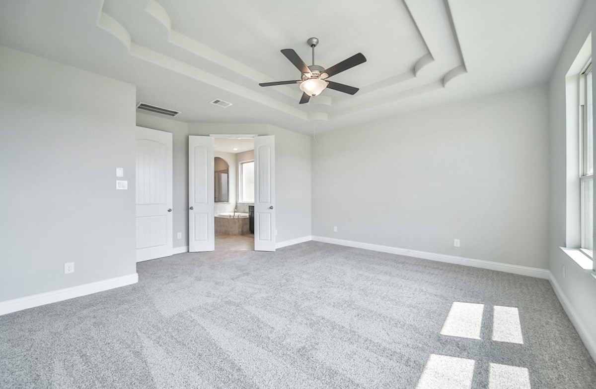 LaGrange quick move-in master bedroom with impressive tray ceiling