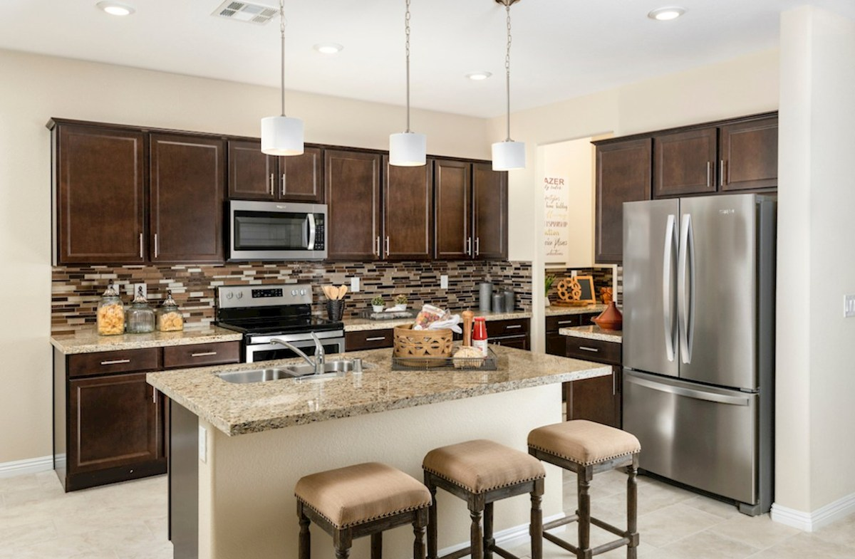 Hawthorne at Sedona Ranch Verano kitchen includes an island