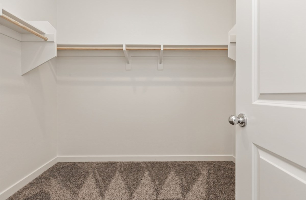 Primrose quick move-in Walk-in closet is designed for easy movement between shelves and optimal hanging and storage space.