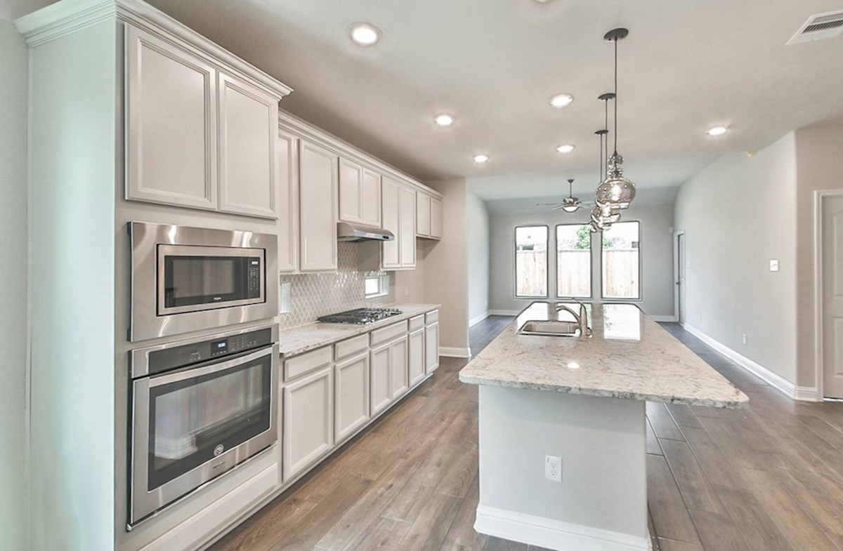 Magnolia quick move-in elegant kitchen with granite countertops