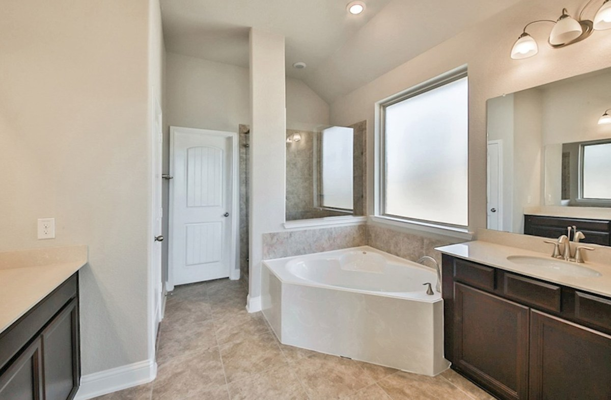 Cameron quick move-in master bath with tile flooring, garden tub and separate shower